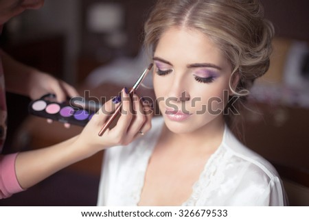 Beautiful Bride Portrait wedding makeup, wedding hairstyle, Wedding dress. Professional stylist makes make-up. soft selective focus.  - stock photo
