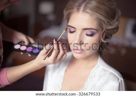Beautiful Bride Portrait wedding makeup, wedding hairstyle, Wedding dress. Professional stylist makes make-up. soft selective focus.  - stock photo