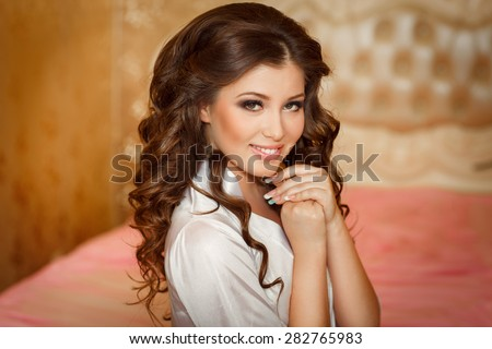 Beautiful Bride Portrait wedding makeup wedding hairstyle Wedding dress. Wedding decoration. Marriage day bride, soft selective focus. gorgeous young bride at home - stock photo