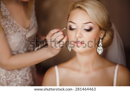 Beautiful Bride Portrait wedding makeup, wedding hairstyle, Wedding dress. Wedding decoration. soft selective focus. gorgeous young bride at home - stock photo