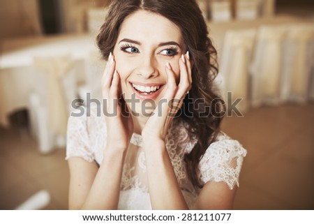 Beautiful bride smiling. Wedding portrait of fiance.  - stock photo