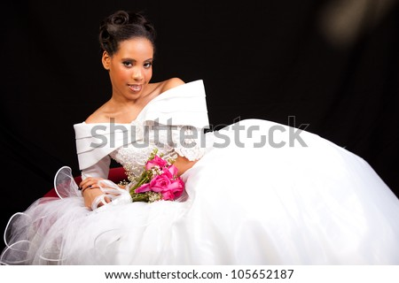 Beautiful Bride with a Bouquet of roses shot in studio - stock photo