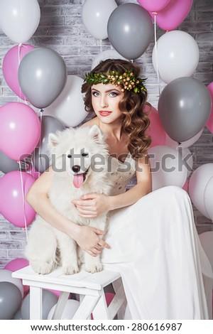 Beautiful bride with a Samoyed dog - stock photo