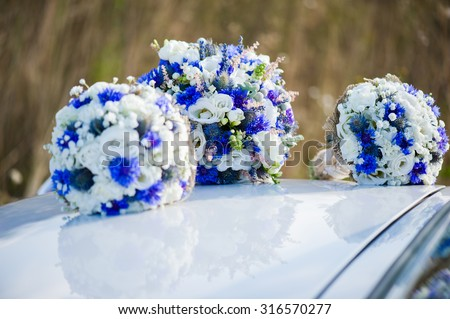Beautiful bride with bouquet before wedding ceremony - stock photo