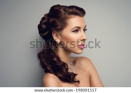 Beautiful bride with fashion wedding hairstyle - stock photo