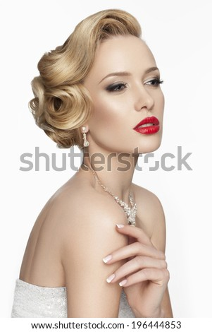 Beautiful bride with fashion wedding hairstyle and evening makeup on white background. Vintage  woman with red lips - stock photo