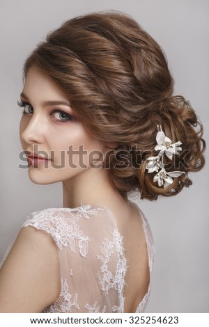 Beautiful bride with fashion wedding hairstyle - on white background.Closeup portrait of young gorgeous bride. Wedding. Studio shot. Beautiful bride portrait - stock photo