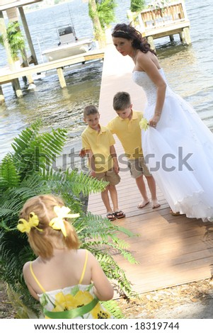 Beautiful bride with her children - stock photo