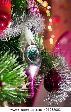 Beautiful bright background with Christmas toy of the spruce needles. - stock photo