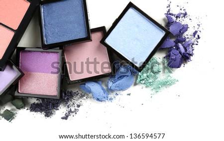 Beautiful bright eye shadows isolated on white - stock photo
