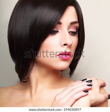 Beautiful bright makeup woman with black short hair style - stock photo