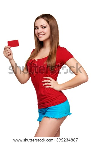 Beautiful bright smiling confident girl showing red card in hand, over white backround - stock photo