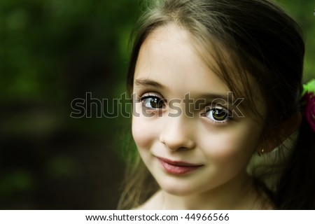 Beautiful brown-eyed brunette girl with a sweet smile - stock photo