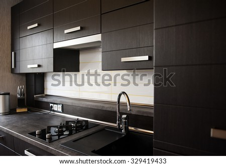 beautiful brown kitchen in a modern style. - stock photo