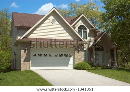 Beautiful brown two story new home. Typical home in the suburbs. Just one of many home or house photos in my gallery. - stock photo