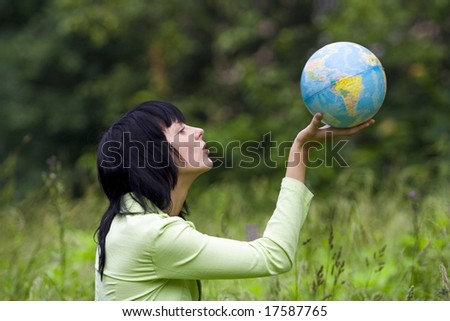 beautiful brunet woman blow global - stock photo