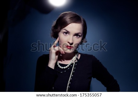 beautiful brunette actress posing in studio. Chanel style - stock photo