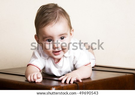 Beautiful brunette baby girl with cute facial expressions - stock photo