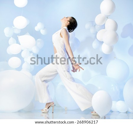 Beautiful brunette beauty on balloon background - stock photo