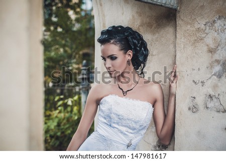 beautiful brunette bride in white wedding dress - stock photo