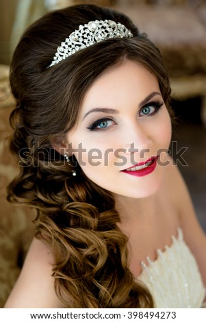 Beautiful brunette  Bride portrait wedding makeup and hairstyle with diamond crown, fashion bride model jewelry and beauty female face, gorgeous beauty bride,bride in luxury wedding dress, - stock photo