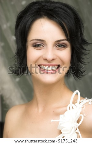 Beautiful brunette bride with short styled hair - stock photo