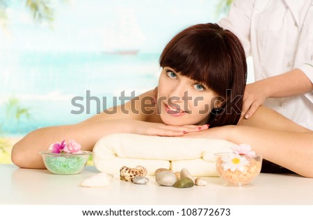 Beautiful brunette doing massage at the spa - stock photo