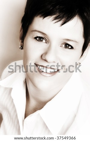 Beautiful brunette female on a light background - stock photo
