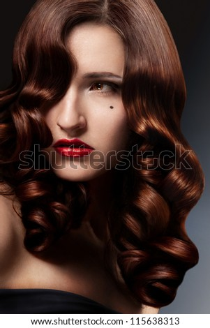 Beautiful Brunette Girl. Healthy Long Curly Hair. - stock photo