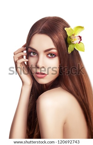 Beautiful Brunette Girl. Healthy Long Hair with Orchid - Spa concept - stock photo