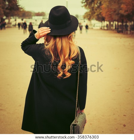Beautiful brunette girl in casual clothes walking around the city. Fashion and city style. Photo with instagram style filters - stock photo
