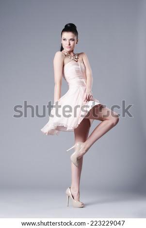 beautiful brunette girl in dress studio shot - stock photo