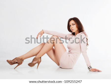 Beautiful brunette girl in studio - stock photo