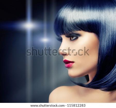 Beautiful Brunette Girl Portrait over Dark Background. Healthy Black Hair - stock photo