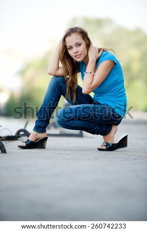 Beautiful brunette girl posing on berth - stock photo