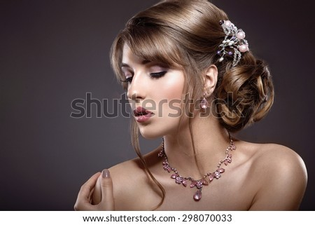 Beautiful brunette girl with evening make-up and perfect skin. Beauty face. - stock photo