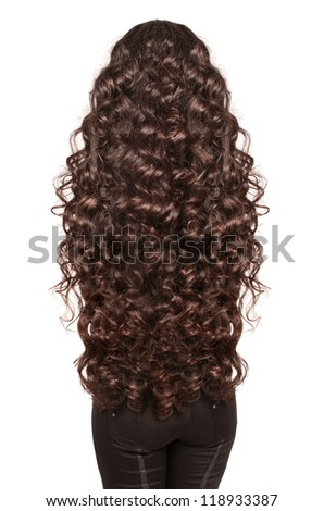 Beautiful Brunette Girl with extra long curly healthy dark Hair. Isolated portrait of woman with gorgeouse hairstyle in studio on whit background - stock photo