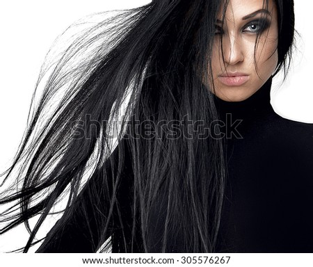Beautiful brunette girl with healthy long hair and blue eyes isolated on a white background - stock photo