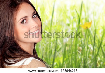 Beautiful brunette girl with herbs of background - stock photo