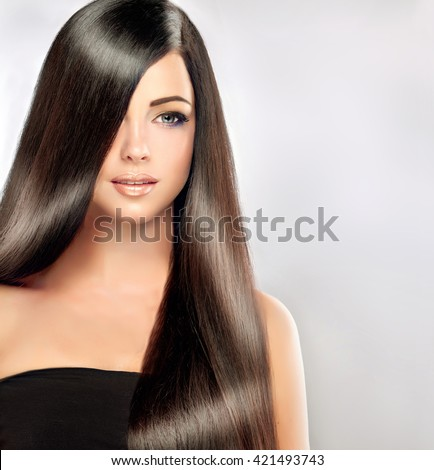 Beautiful brunette girl with long and straight black hair . Shiny smooth  and healthy well-groomed hair  - stock photo