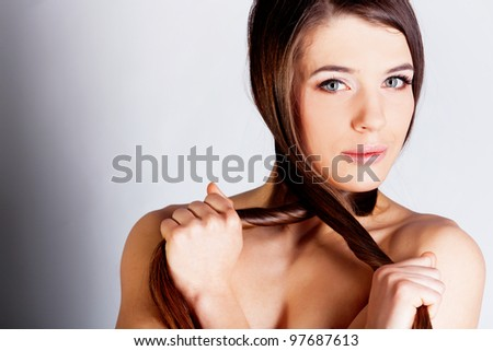 Beautiful brunette girl with long hair - stock photo