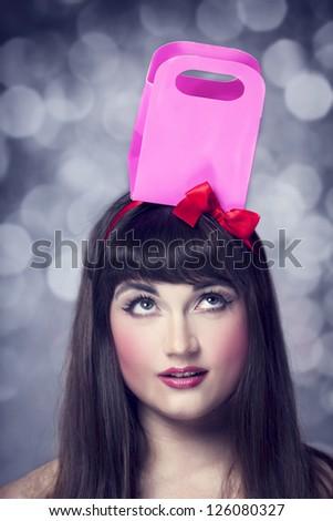 Beautiful brunette girl with present box. - stock photo