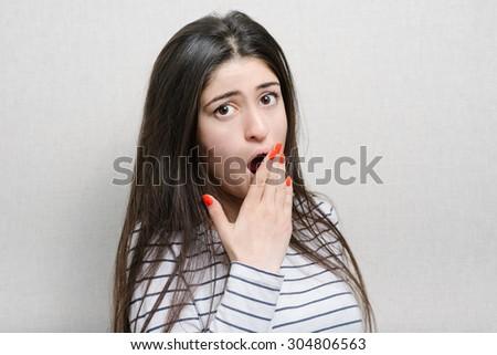 beautiful brunette girl yawns - stock photo