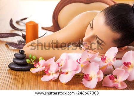 beautiful brunette in a massage parlor. spa - stock photo