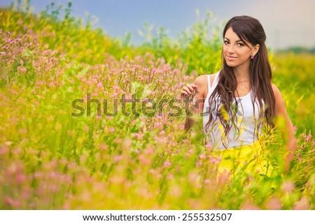 Beautiful brunette  in field - stock photo