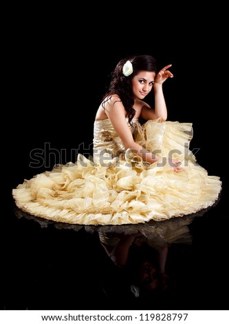 beautiful brunette in formal dress on a black background - stock photo