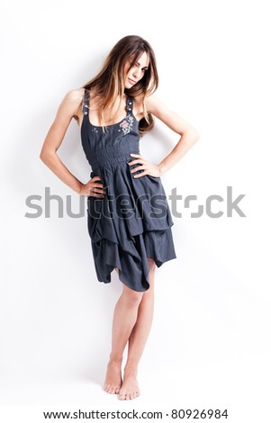 beautiful brunette in summer dress, studio shot, full body shot - stock photo