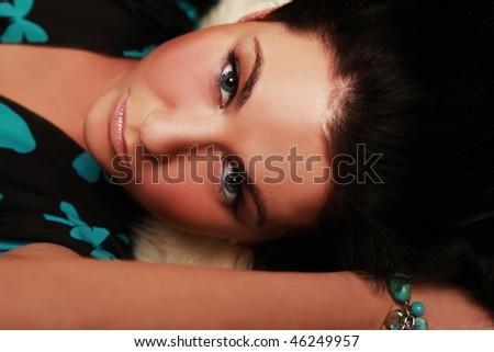 beautiful brunette lying in studio - stock photo