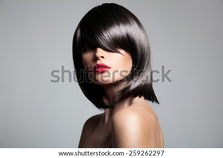 Beautiful brunette model with perfect glossy hair. Close-up portrait. - stock photo