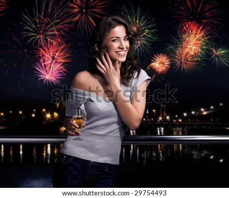 Beautiful brunette on a fireworks background - stock photo